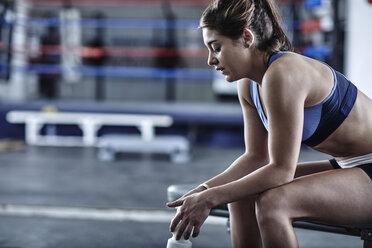 Athlete in gym having a break - ZEF002633