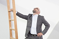 Businessman holding career ladder - RBF002161