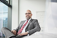Portrait of confident businessman in office - RBF002179