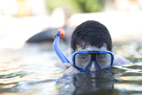Young man with diving goggles in water - ZEF003290