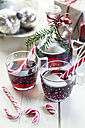 Glasses of mulled wine, candy canes and Christmas decoration - SBDF002166