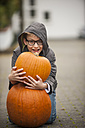 Smiling boy with two big pumpkins - PAF001095