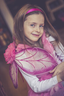 Portrait of smiling little girl masquerade as a fairy - SARF001158