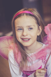 Portrait of smiling little girl masquerade as a fairy - SARF001156