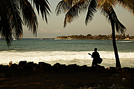 USA, Hawaii, view to man with guitar standing at seashore - STK001105