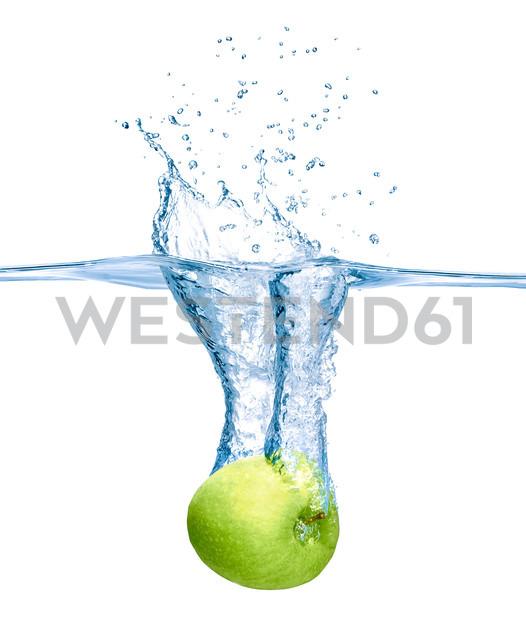Green apple falling into water - RAMF000027