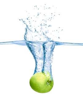 Green apple falling into water - RAMF000027