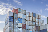 Germany, Hamburg, Stacked shipping containers at harbour - NKF000214