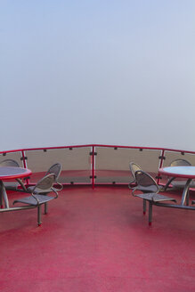 Germany, Hamburg, upper deck of a harbor ferry in dense fog - NKF000221