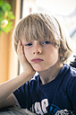 Portrait of bored little boy with head in his hand - SARF001169