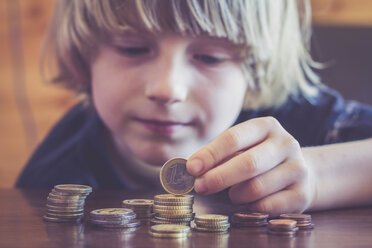 Little boy counting coins - SARF001172