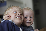 Two happy little brothers at home - RB002213