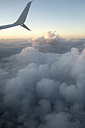 Germany, Aerial view, Airplane and clouds in the evening - NDF000486