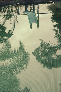 Pool, mirroring trees and water slide, Sydney, New South Wales, Australia - SBDF001585