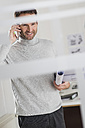 Architect in office on cell phone - UUF002948