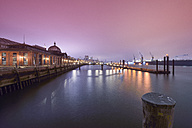 Germany, Hamburg, harbor, historic fish market hall at night - RJ000372