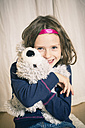 Little girl cuddling her teddy bear - SARF001182
