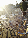 Spain, Majorca, empty chairs and tables in a line, backlight - MSF004382