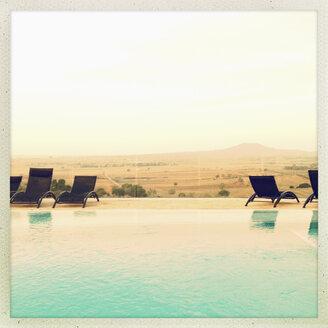 Spain, Majorca, poolside, deckchairs, horizon, landscape - MS004392