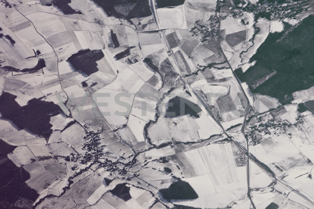 View of town in snowy fields as seen from an airplane - MFF001334
