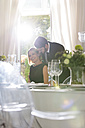Elegant couple in restaurant - WESTF020395