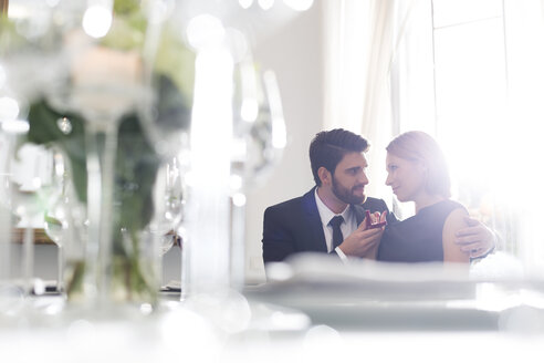 Elegant couple with engagement ring in restaurant - WESTF020407
