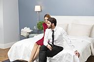 Elegant couple sitting on bed - WESTF020452