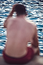 Spain, Balearic Islands, Menorca, man in front of the sea, blurred - EH000015