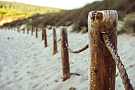 Spain, Balearic Islands, Menorca, Cala bay, fence on beach - EHF000012