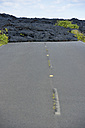 USA, Hawaii, Big Island, Volcanoes National Park, congealed lava on the lane of old Chain of Craters Road - BRF000941