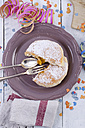 Dish with Berliner, streamer and confetti on wood - ODF000931