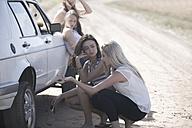 South Africa, Friends on a road trip having a car breakdown - ZEF002777