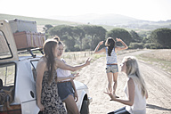 South Africa, Friends on a road trip having a car breakdown - ZEF002696