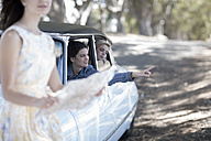 South Africa, Young woman on road trip with friends looking for directions - ZEF002779
