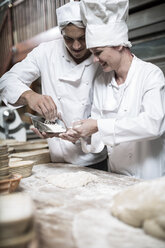 Two bakers working together - ZEF003782