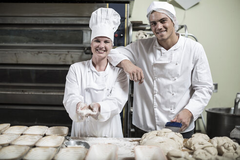 Portrait of two smiling bakers - ZEF003794