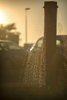 Spain, Andalusia, Huelva, beach shower at backlight - EH000049