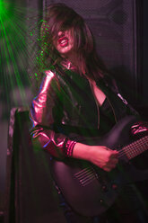 Female rock guitar player with black guitar - ZEF003564