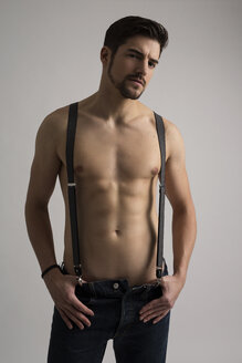 Shirtless man wearing jeans and suspenders - SHKF000121