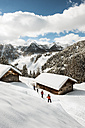 Austria, Salzburg State, Altenmarkt-Zauchensee, four skiing people - HH005018