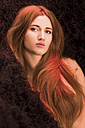 Portrait of seductive young woman with long red hair - FCF000597