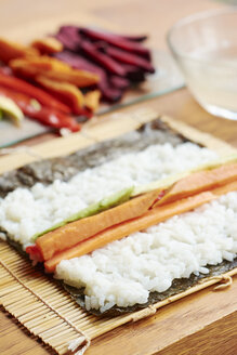 Nori sheet covered with sushi rice and a vegetable filling - HAWF000567