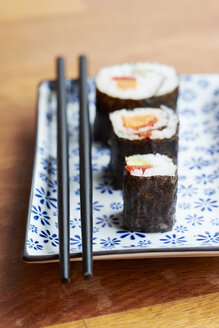 Vegetable sushi filled with sweet potato, carrots, avocado and bell pepper - HAWF000568