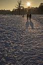 Germany, Bavaria, Munich, people walking in snow - FCF000603