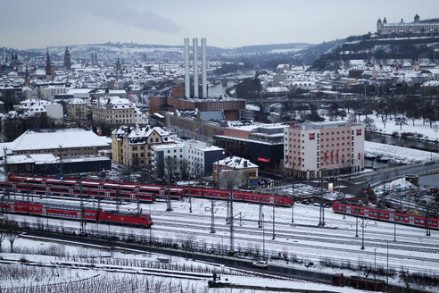 Germany, Wuerzburg, cityscape with trains in winter - NDF000492