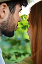 Young couple sharing an intimate moment outdoors - WESTF020695