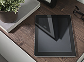Digital tablet lying on sideboard - PDF000664