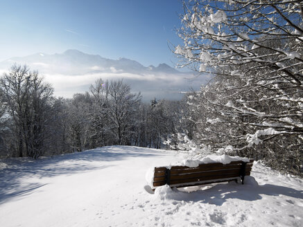 Germany, Kochel am See, snow-covered bench at observation point - LAF001375