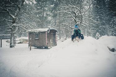 Germany, Bavaria, Berchtesgadener Land, boy on sledge - MJF001377