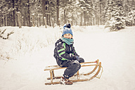 Germany, Bavaria, Berchtesgadener Land, happy boy on sledge - MJF001383